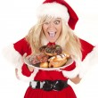 Stock Photo: Mrs santa donuts excited
