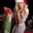 Woman getting out of car with gifts — Stock Photo
