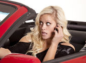 Blond woman phone car — Stock Photo