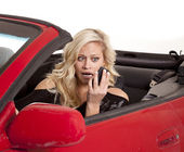 Blond woman phone car frustrated — Stock Photo