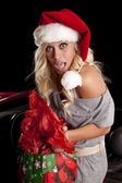 Woman caught by car with gifts — Stock Photo
