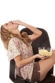 Fill mouth with popcorn — Stock Photo