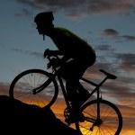 Silhouette road bike uphill — Stock Photo
