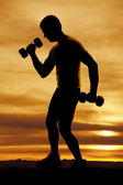Man weights silhouette workout — Stock Photo