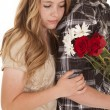 Woman lean on mans back with flowers — Stock Photo #29194639