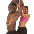 Woman helping man lift weight side him smile — Stock Photo #29197887