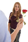 Girl reaching out to grab rose from guy — Stock Photo