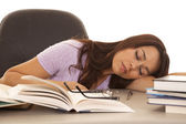 Woman purple shirt asleep books — Stock Photo