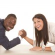 Business man and woman arm wrestle laugh looking — Stock Photo #29386017