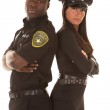 Male and female cop back to back serious — Stock Photo #29386605