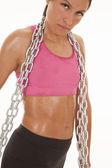 Woman pink sports bra chain close — Stock Photo