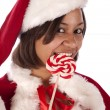 Santa's helper holding a sucker — Stock Photo