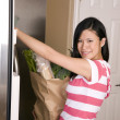 Woman putting her groceries away — Stock Photo