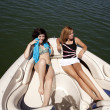 Women sitting on a boat relaxing — Foto Stock