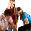 Man and two girls working on the computer — Stock Photo