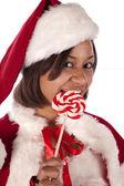 Santa's helper holding a sucker — Stock Photo