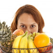 Peeking over fruit — Stock Photo #29576483