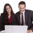 Couple looking at laptop smiling — Stock Photo #29577137