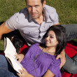 Stockfoto: Couple with dog reading