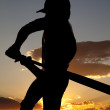 Silhouette baseball swing beginning sunset — Stock Photo