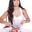 Woman with plate of steaks licking. — Stock Photo