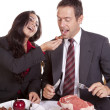 Couple eating her feeding him — Stock Photo