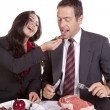 Stock Photo: Couple eating her feeding him