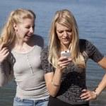 Woman lake phone laugh — Stock Photo #29579601