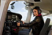 Woman in airplane cockpit — Foto Stock