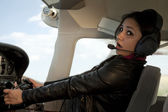 Woman scared flying airplane — Stock Photo