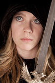 Girl face sword — Stock Photo