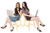 Two women laptops peeking — Stock Photo