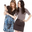 Two women looking at phone — Stockfoto