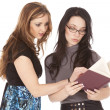 Two women reading book — Stock Photo