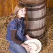Woman by barrel looking up — Stock Photo