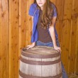 Woman by barrel serious expression — Stock fotografie