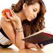 Holding apple and book — Stock Photo
