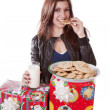 Eating cookie presents — Stock Photo