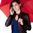 Woman On Phone Looking Up Umbrella — Stock Photo