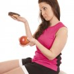 Woman fitness sad donut apple — Stock Photo