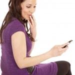 Woman in purple back smirk phone — Stock Photo