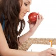 Woman on floor with apple writing — Stock Photo