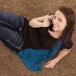 Woman on floor phone top view — Stock Photo