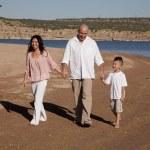 Family walking on beach happy — Stock Photo #29584337