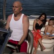Stock Photo: Man drive boat family behind