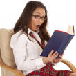 School girl reading shocked chair — Stock Photo