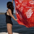 Woman boat bow sarong blow — Stockfoto