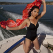 Woman sarong blow boat — Stockfoto