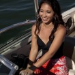 Stock Photo: Woman smile drving boat