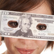 Stock Photo: Greed eye hold money